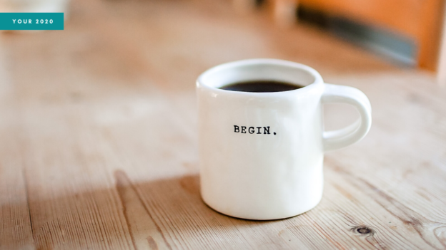 Website header showing a mug with the word 'BEGIN' on the side